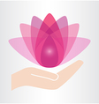 Hand and lotus flower icon vector image