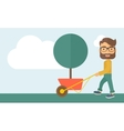 Young man pushing the cart with tree vector image