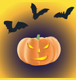 halloween pumpkin with burning eyes on a dark vector image