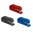 three colorful staplers vector image