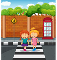 Two girls crossing the road vector image