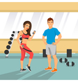 a fit couple in an a gym vector image