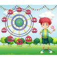 A boy holding a lollipop beside a ferris wheel vector image vector image