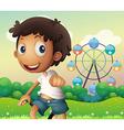A boy standing across the ferris wheel vector image