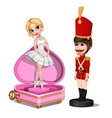 Wooden soldier toy and music box with ballerina vector image