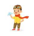 cute little boy in pilot glasses playing with vector image