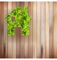Leaves home icon on wooden  EPS10 vector image vector image