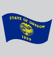 flag of oregon waving on gray background vector image