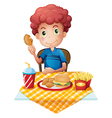 A hungry boy eating vector image vector image
