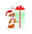 funny cartoon dog in santa hat hugs xmas gift vector image