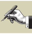 Hand with a pen vector image