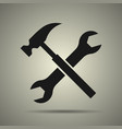 hammer and spanner tools icon vector image
