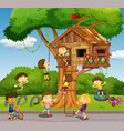 Kids playing at treehouse in park vector image