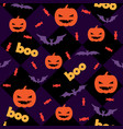 seamless halloween pattern with pumpkins candy vector image