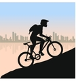 Cyclist in rough road against city landscape vector image