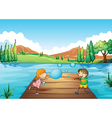A young girl and boy playing with the bubbles vector image