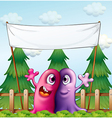 Two loving monsters under the empty banner vector image