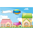 A balloon above the village with an empty banner vector image