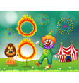 A lion and a clown with a ring of fire vector image vector image