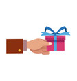 hand holding gift box wrap ribbon decoration vector image