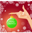 Woman hand with Christmas ball vector image
