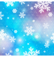Blue background with bokeh and blurred snowflakes vector image