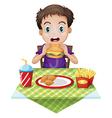 A boy eating vector image vector image