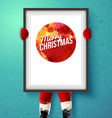 Christmas card Santa is holding a frame with vector image