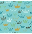 Crowns seamless pattern on blue background vector image