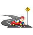 A young boy near a yellow signage with his car vector image vector image