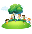 Children playing football in the park vector image vector image