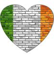 Ireland flag on a brick wall in heart shape vector image