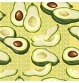 Seamless texture with avocado and slices on yellow vector image