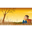 A young boy above the hill resting vector image vector image