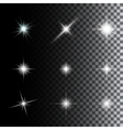 Set of glowing light effect stars vector image