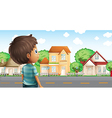 A young boy standing across the village vector image