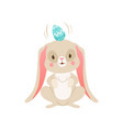 cute cartoon bunny with egg on its head funny vector image