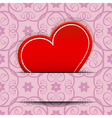 Red heart inserted in paper cut card vector image