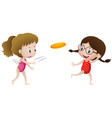 two girls playing frisbee vector image