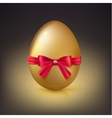Golden Easter egg with red ribbon and bow vector image