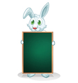 A bunny holding an empty board vector image vector image