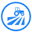 farm field with tractor rounded grainy icon vector image