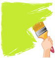 Hand with brush paints the wall vector image