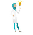 doctor pointing at bright idea light bulb vector image