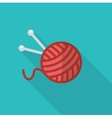 A ball of wool and knitting needles vector image