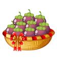 A basket of eggplants vector image vector image