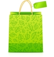 Green paper shopping bag with floral ornament vector image vector image