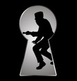 silhouette of a thief seen through a keyhole vector image