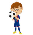 little boy in uniform holding soccer ball isolated vector image
