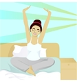 Girl stretches in bed in morning vector image